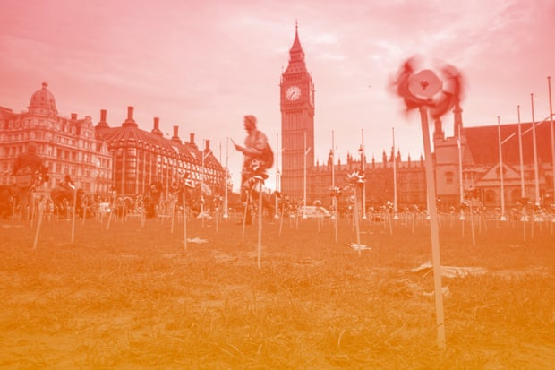 Climate campaigners cover Parliament Square.